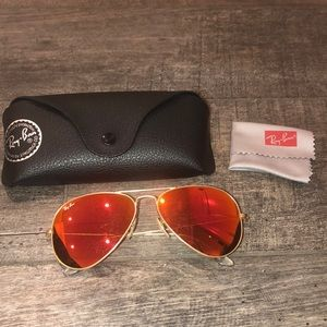 Red reflective women's Ray-Ban aviator sunglasses